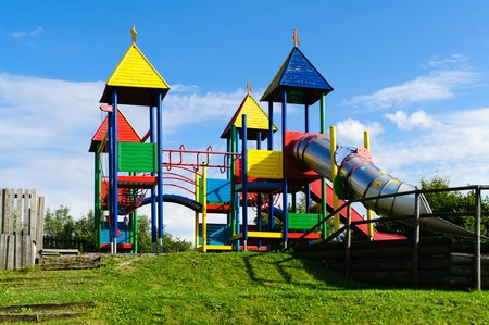 Colorful empty outdoor playground with big slide photo