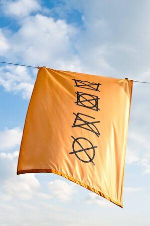 Yellow Laundry Symbol photo