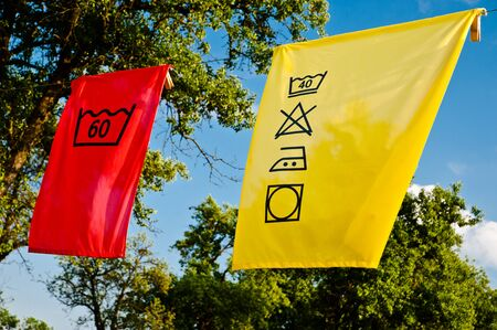 Cleaning symbols on a yellow cloth photo
