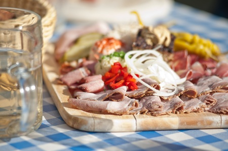 Austrian traditional plate of cold-cuts with self-made ingredient on wooden plate Standard-Bild