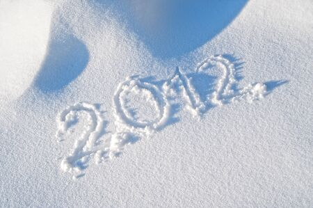Detail of Year 2012 written in the Snow Stock Photo - 11180809