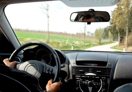 Drive through the landscape with hands on the steer