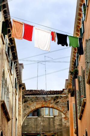 Fresh laundry hanging between two houses in venice photo