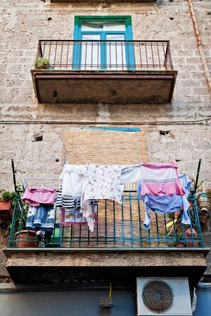 Italian House with laundry hanging in the balcony photo