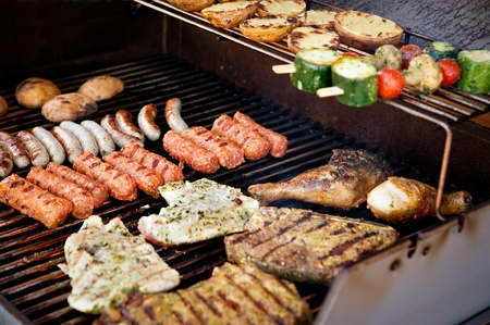 home party: Vegetables, steak and other meat on a BBQ