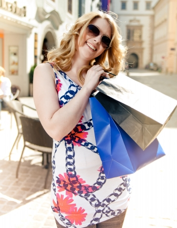everyday people: Happy blonde woman goes Shopping