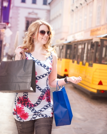 Shopping Woman with bags in her hand in the City photo