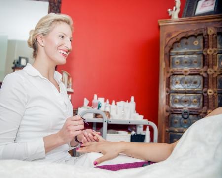 manicurist: Blonde manicurist have fun with her client