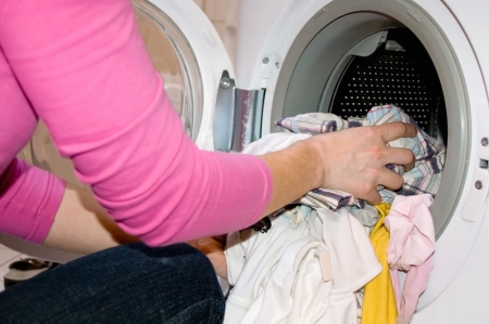 Woman filling Washing Machine