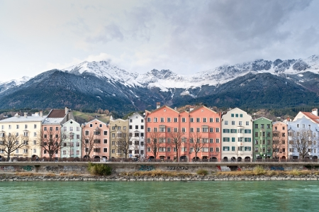 Row of Houses in Innsbruck, in the Background the austrian Alps photo
