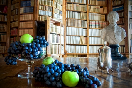 public library: Still Life with grapes and apples in an old library