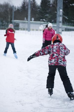 skating fun: Children taken from behind does Ice Skating