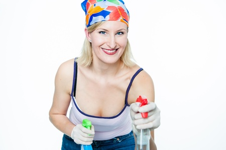 housewife gloves: Cheerful Housewive with two Spray Bottles in her Hand Stock Photo