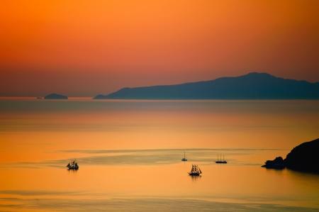santorini greece: Sunset in the sea of santorini, greece Stock Photo