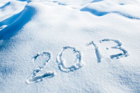 Year 2013 written in a winter landscape photo