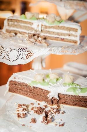 marzipan: Partially eaten wedding cake on a cake stand