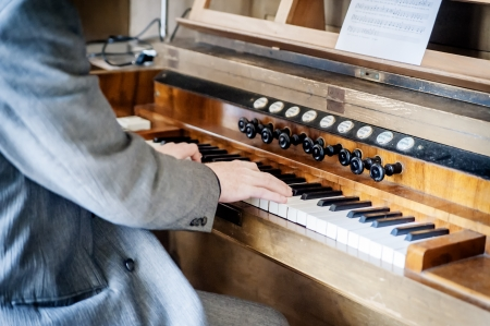 Man playing an old pipe organ in the church Stock Photo - 18256206
