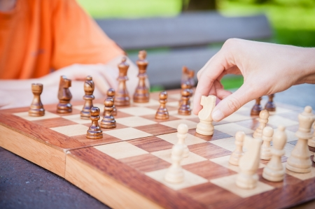 chess game: Playing chess, hand moving piece Stock Photo