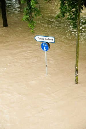 linz: High Water on the Danube River and Sign Stock Photo