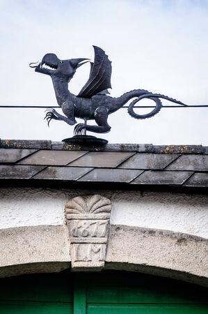 dragon vertical: Metal Dragon on the top of a farm