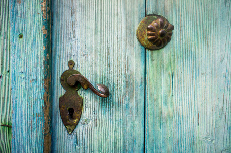 door bolt: Detail of an old Door with a doorknob Stock Photo