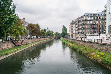Canal with reflections and buildings in Strasbourg, France photo