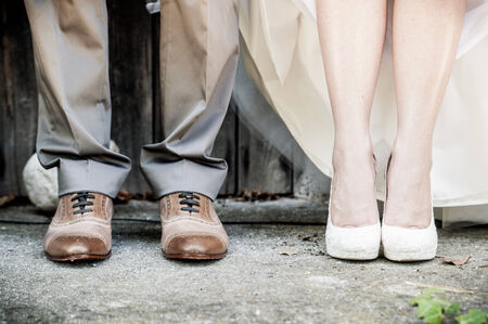detail view of the feet of a wedding couple photo