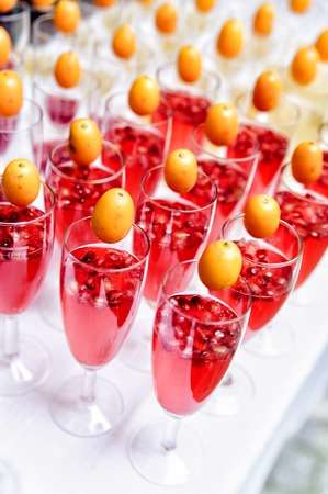 party tray: lot of red sparkling drinks on buffet table Stock Photo