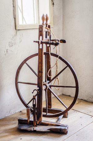 antiquities: Old spinning wheel in a room of an austrian farm Stock Photo