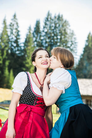 tracht: Young Woman in traditional austrian clothes having Fun Stock Photo