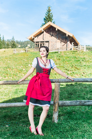 german swiss: Young Woman with traditional austrian clothes in the Alps
