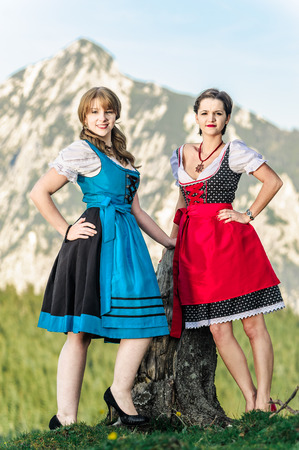 tracht: Austrian Women with traditional clothes in the Alps