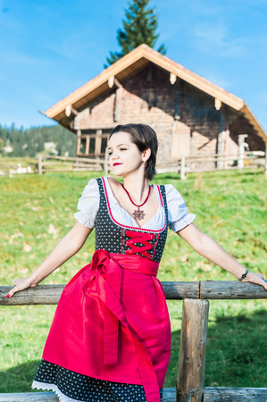 Austrian Beauty with traditional clothes in the Alps photo