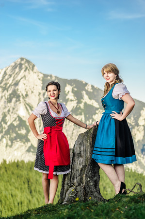 beauties: Austrian Beauties with traditional clothes in the alps