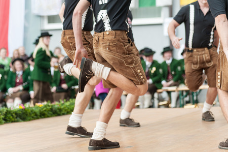 Young men doing an austrian traditional folk dance Stock fotó