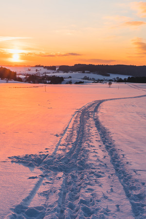 upper austria: Landscape with trail on snow at sunset taken in upper austria