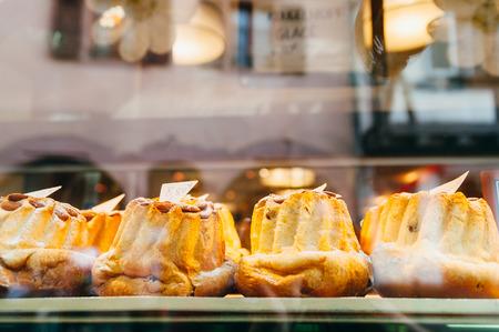 vitrine: Bundt cakes behind a vitrine in a bakery shop