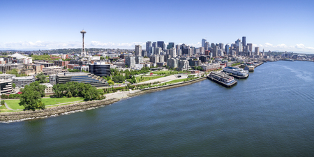 Aerial drone perspective with birds eye view on Elliot Bay with Puget Sound ocean water and city skyline of downtown skyscraper buildings in Pacific Northwest