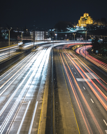 Long exposure of headlight laser beams along Interstate 5 road on dark night Reklamní fotografie