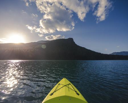 Golden hour kayaking adventure on alpine lake near Seattle Washington
