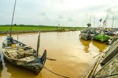 downstream: Boats Fishermen Indonesian people on the river downstream. Stock Photo