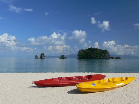 langkawi: Brightly coloured sea kayaks on a perfect beach. Langkawi Island, Malaysia