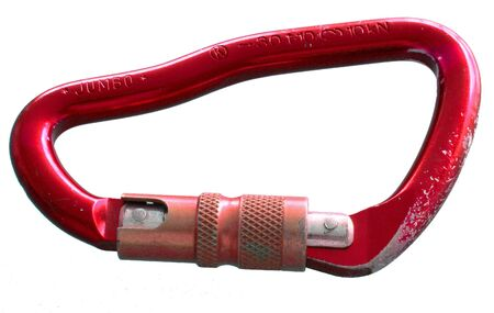 abseil: A red Carabiner. Worn from use. Isolated on white