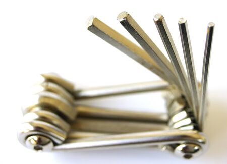 hex key: A shiny, metal multi-tool, with various sizes of hex key showing Stock Photo