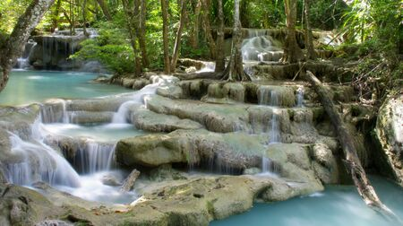 erawan: Beautiful tiered waterfall and turquoise pools in a tropical rainforest. Erawan National Park, Kanchanaburi Province Thailand Stock Photo