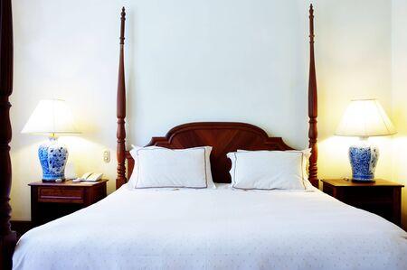 four poster: four post wooden bed and bedside tables