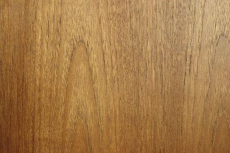 slight: Edge to edge teak wood texture. Slight side light to highlight contours. Stock Photo