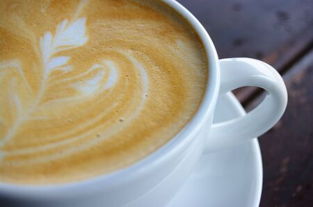foamy: Closeup shot of foamy crema latte art