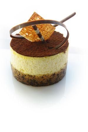 Tiramisu - the delicious, creamy, coffee soaked dessert. Shot on white. photo