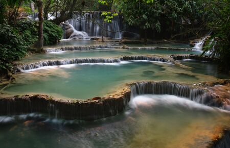 Kuang Si falls -  a series of waterfalls, cascades and azure green pools about 25km South-west of Luang Prabang, Laos  photo